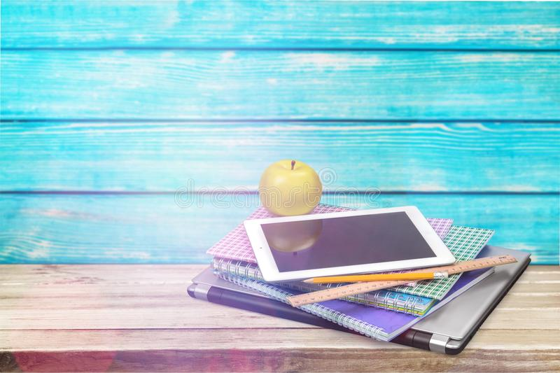 Digital tablet and books on the table royalty free stock photo