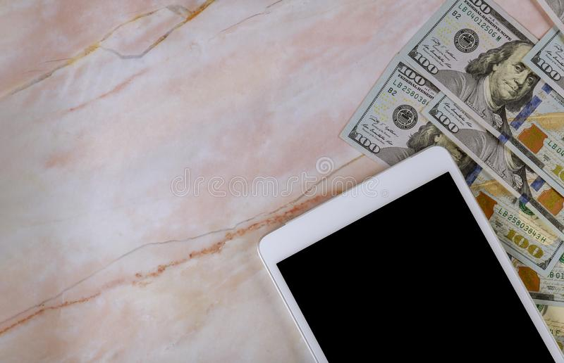Digital tablet computer with isolated screen in over cash money american dollars stock photos