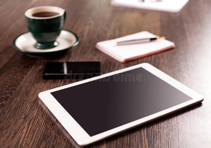 Download Digital Tablet Computer With Note Paper And Cup Of Coffee On Old Wooden Desk Stock Photo - Image of message, news: 45862718