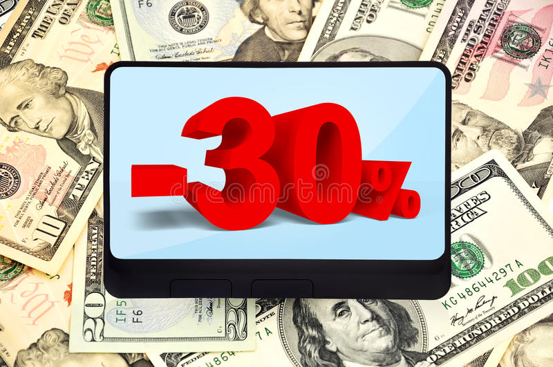 Digital tablet with discoun. T on background of dollars royalty free stock photo