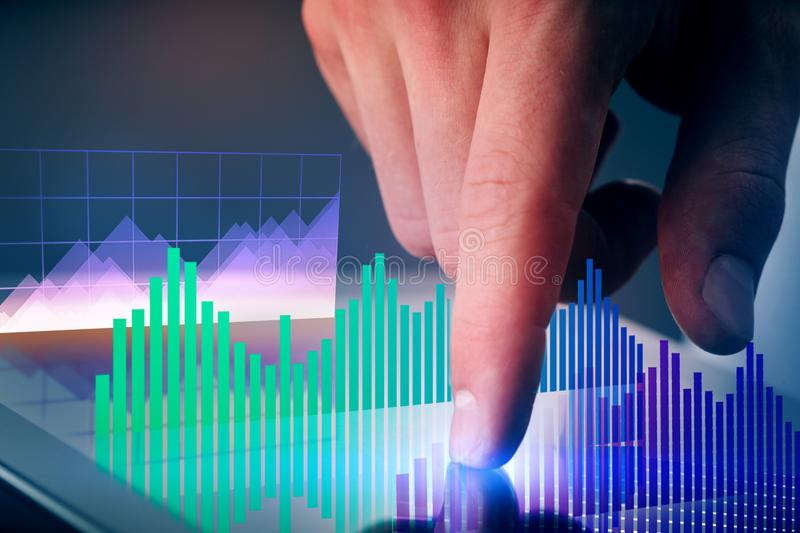 Digital tablet with financial graphs stock photo