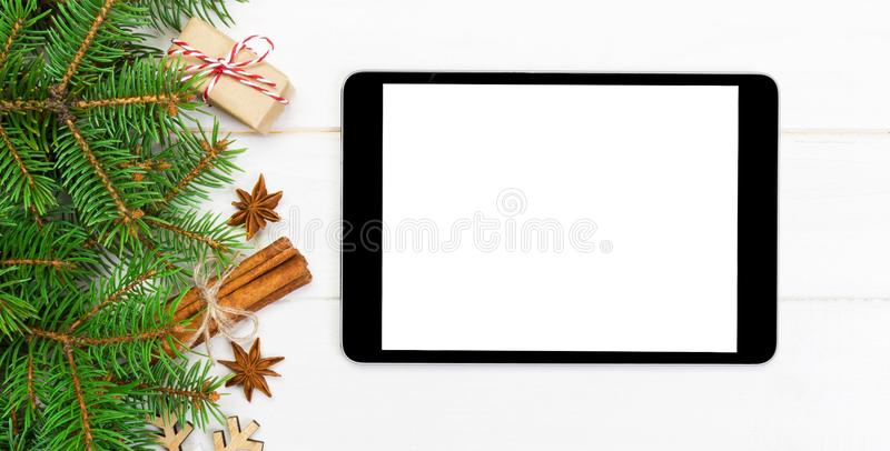 Digital tablet mock up with rustic banner Christmas wooden background decorations for app presentation. top view with copy space.  stock photos