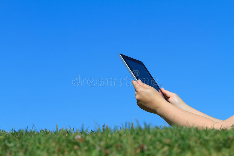 Digital tablet outdoors stock photo