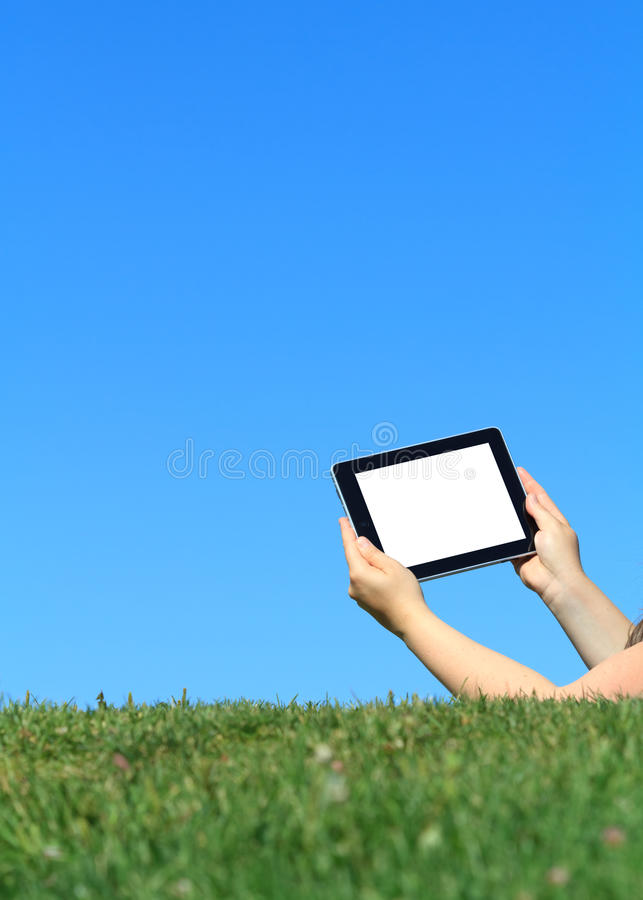 Digital tablet outdoors royalty free stock photography