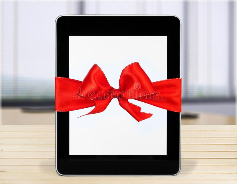 Digital tablet with ribbon stock images