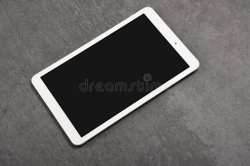 Digital tablet screen has clipping path on gray stone background stock image