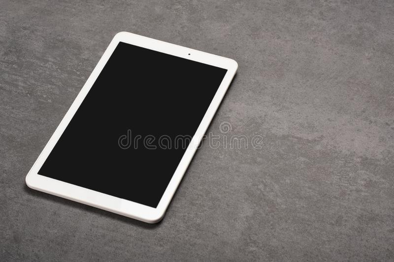 Digital tablet screen has clipping path on gray stone background royalty free stock photography