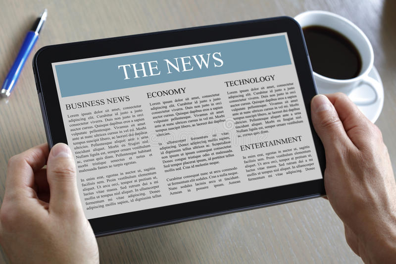Digital tablet showing news. Reading the news on a digital tablet