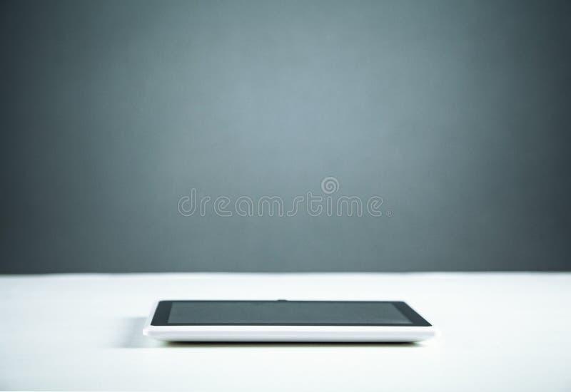 Digital tablet on white desk stock image