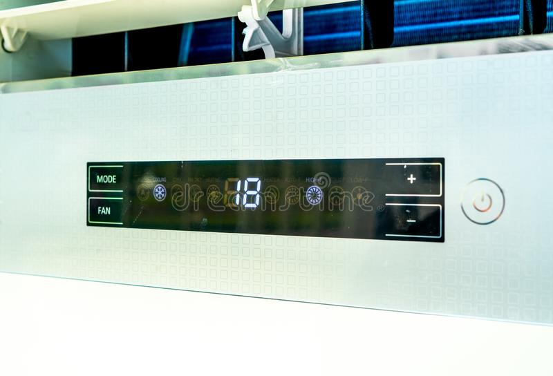 Digital Temperature Control Panel of Air Conditioner with 18 Degree Celsius and Mode. Fan Sign stock photo