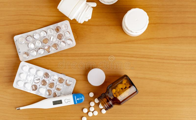 Digital thermometer and various medicine stock photos