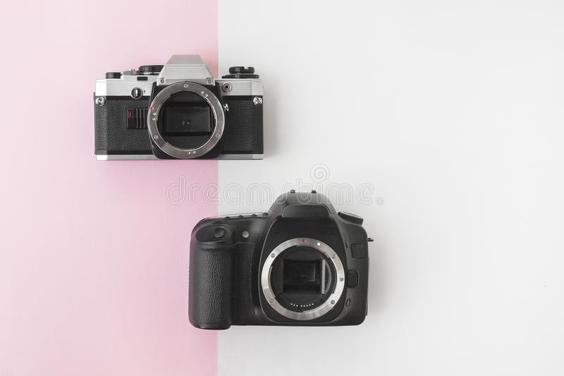 Digital versus Analog SLR Camera on Pink Background with Copyspace royalty free stock photo