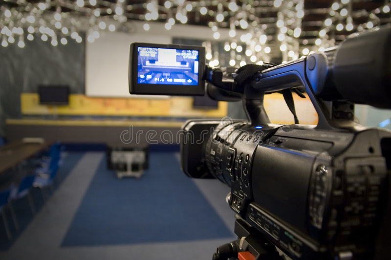 Digital video camera. Shoots meeting - view in video camera display - 3CCD Camcorder