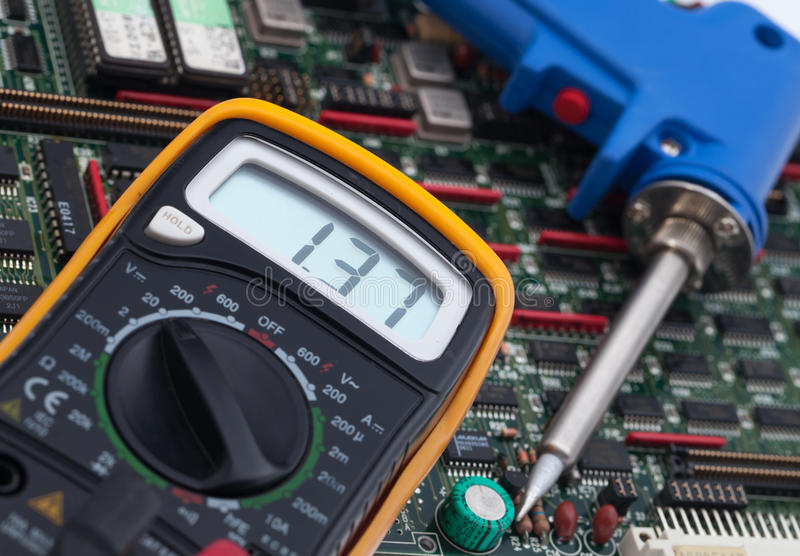 Digital Voltmeter and PCB.  royalty free stock photos