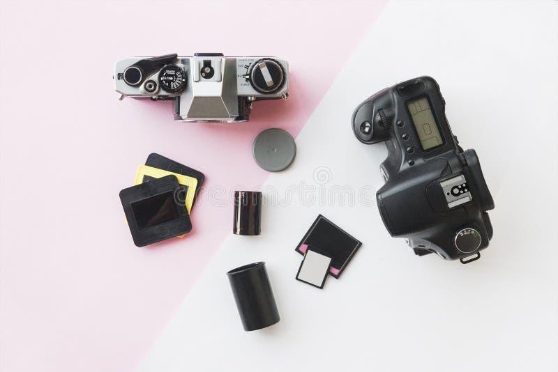 Digital vs. Analog SLR Camera with Slides, Memory Cards, 35 mm Film royalty free stock photos
