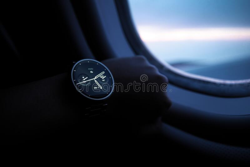 Digital watch inside airplane royalty free stock photos