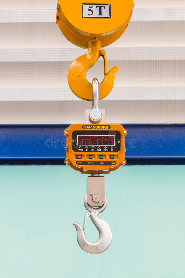 Digital weight scale. Industrial type 5000 kg digital weight scale hanging on hook of the crane, with clipping path royalty free stock photos