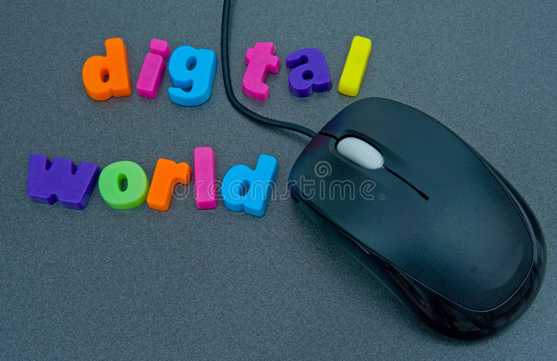 Digital world. A macro image of digital world in colorful lower case letters with the cable of a personal computer mouse replacing the letter 'i royalty free stock photo