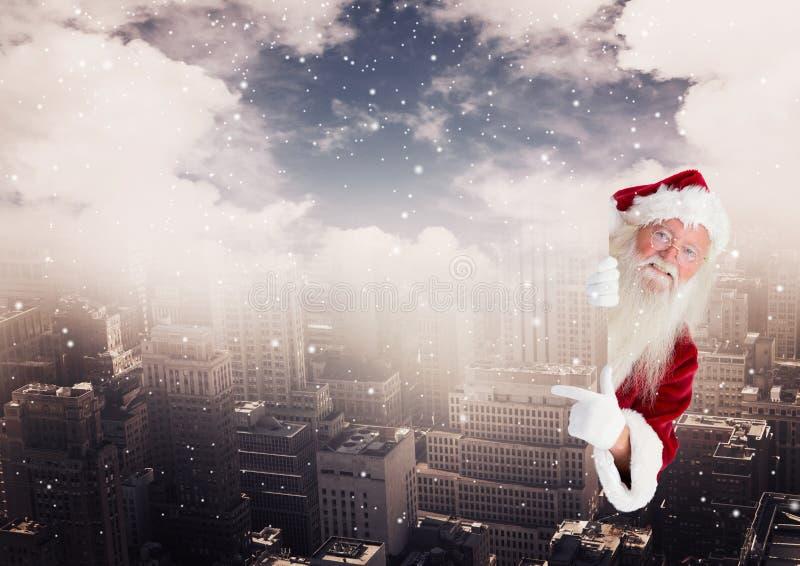 Digitale samenstelling van de Kerstman die van de gebouwen gluren stock afbeelding