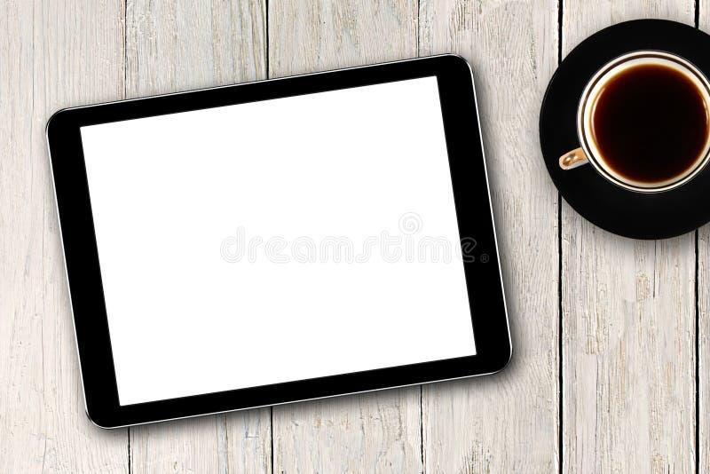 Digitale tablet en koffiekop royalty-vrije stock foto's