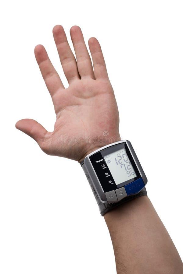 Digitale tonometr op menselijke hand stock afbeeldingen