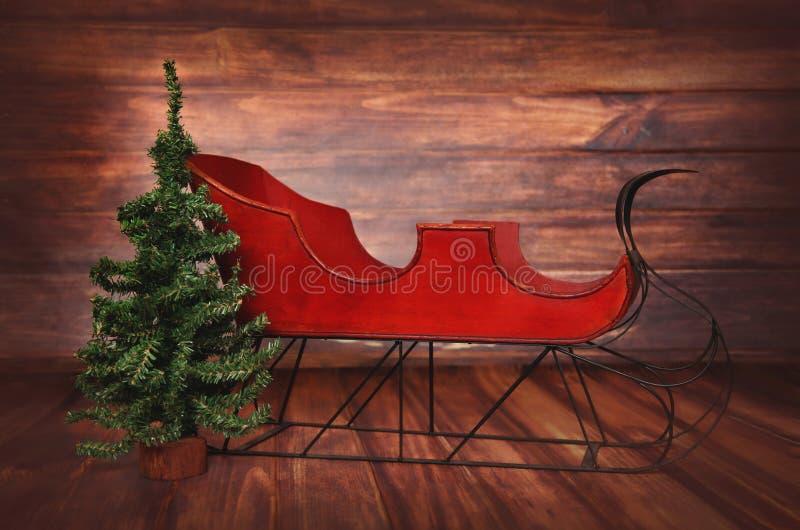 Digitalfotografie-Hintergrund des roten Weinlese-Weihnachtspferdeschlittens stockbilder