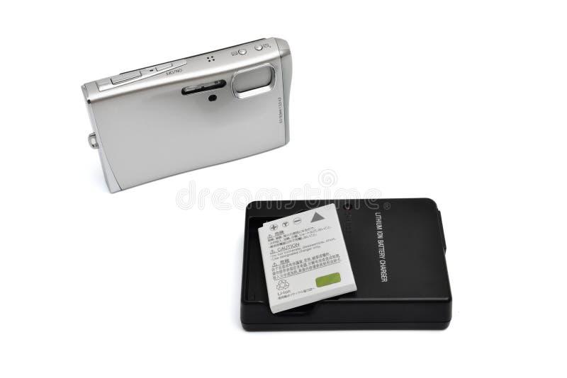 Digitalkamera und Batterie lizenzfreies stockbild