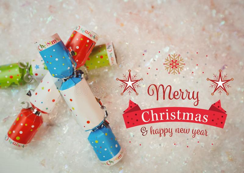 Digitally composite image of merry christmas and happy new year message against christmas crackers royalty free illustration