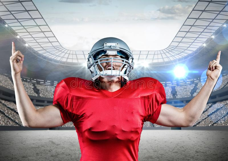Digitally generated image of american football player cheering with clenched fist royalty free stock photo