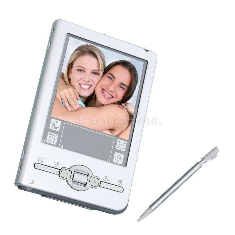 Digitals PDA et aiguille au-dessus de blanc photographie stock libre de droits