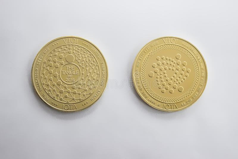 Digitalt mynt för Crypto valuta - jotaframdel och baksida arkivbild
