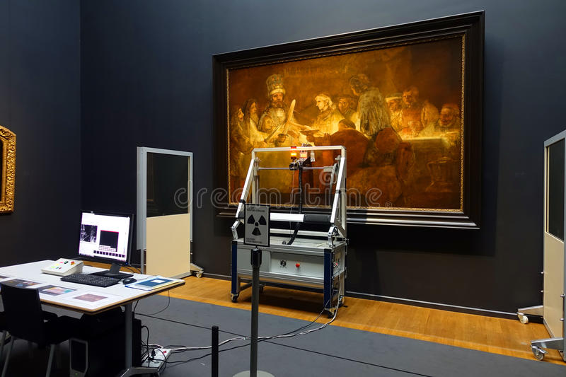 Digitizing Art. The workspace of a digital technician in the process of scanning and digitizing a large scale painting for the purpose of examining and archiving royalty free stock photography