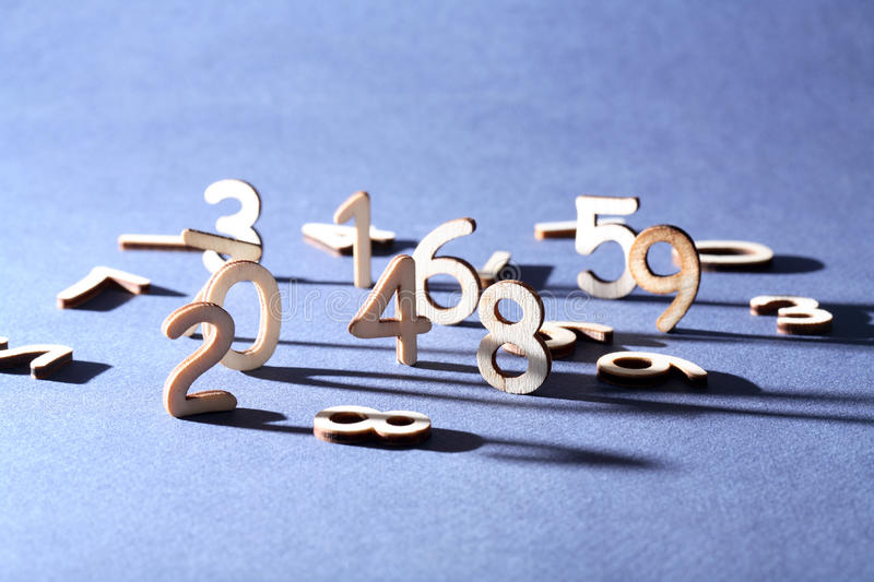 Digits Concept. Bookkeeping symbol. Set of wooden digits on gray background stock photography
