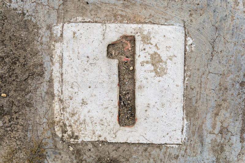 The digits with concrete on the sidewalk 1 royalty free stock images