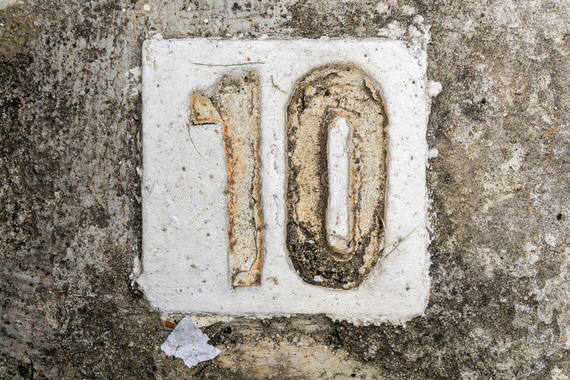 The digits with concrete on the sidewalk 10 royalty free stock image