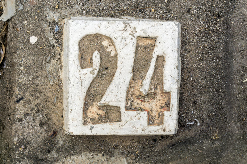 The digits with concrete on the sidewalk 24 stock photo