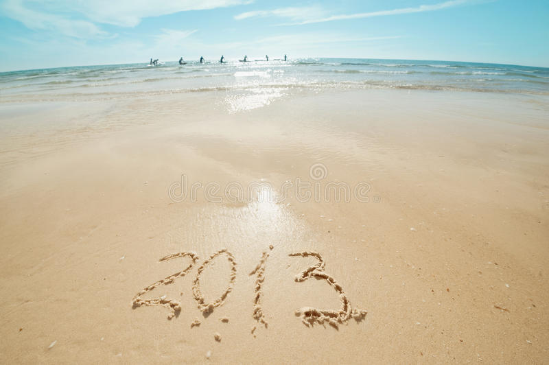 Digits on the sand. Digits 2013 on the sand seashore - concept of new year royalty free stock photography