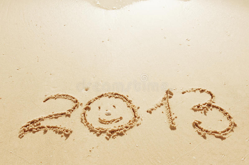Digits on the sand. Digits 2013 on the sand seashore - concept of new year stock photos
