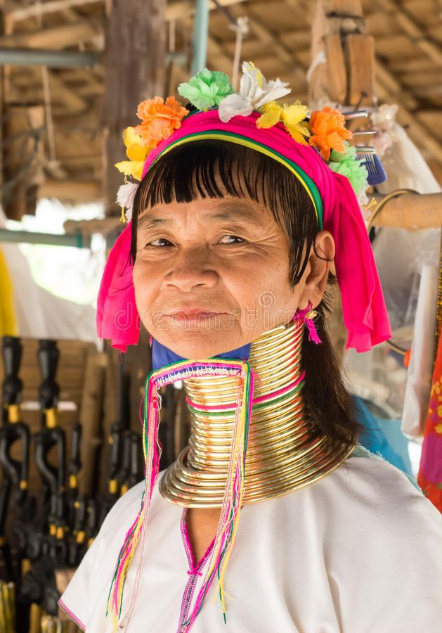 Dignified elderly Karen long-neck woman wears traditional brass neck coils and poses in stock photo