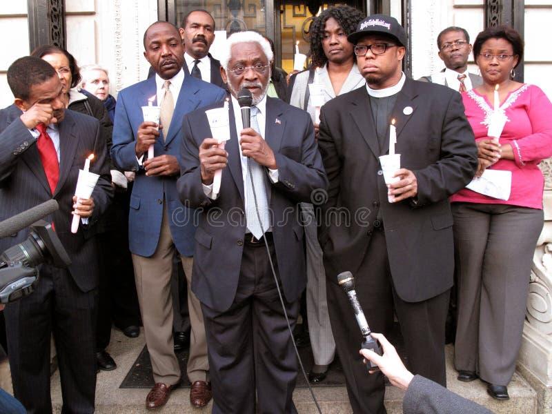 Dignitaries at the Embassy of Haiti. Photo of ambassador raymond joseph holding the microphone at the embassy of haiti in washington dc on 1/19/2010 during a royalty free stock image