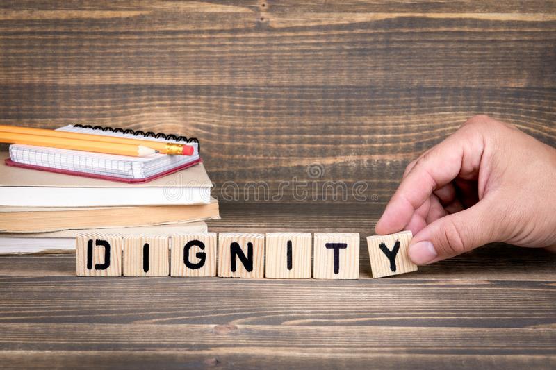 Dignity business concept. Wooden letters on the office desk stock photography