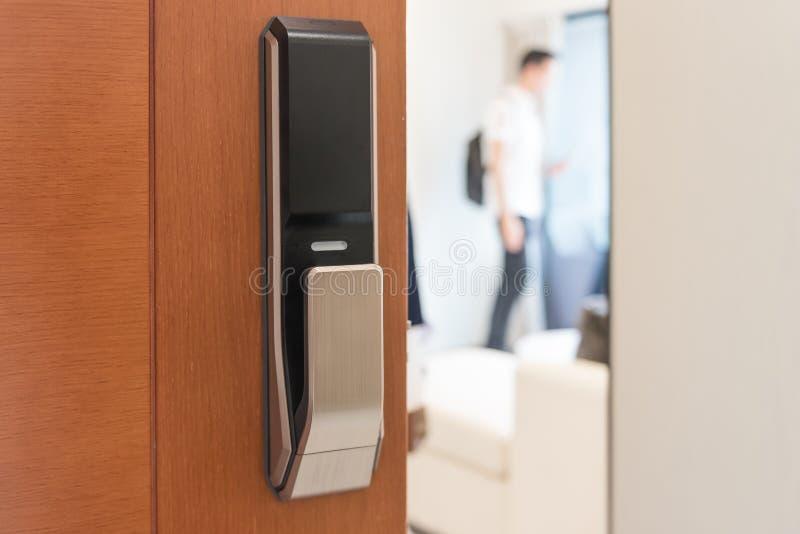 Digtal door lock on wooden door royalty free stock photo