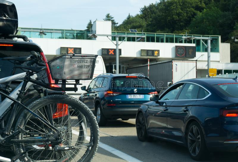 Many cars passing through a toll booth stop in heavy summer holiday traffic on the French highway system royalty free stock image
