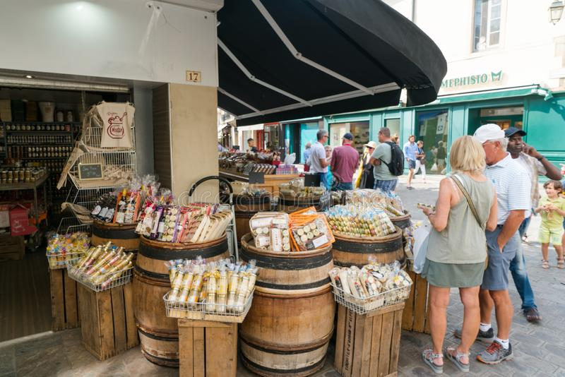 Tourists browsing for souvenirs in a Dijon mustard shop in Dijon stock image