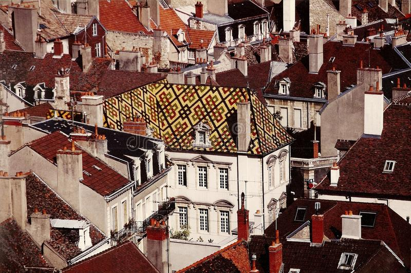 Dijon, France: 17th Century Hôtel de Vogué. The distinctive yellow, deep coral, and black patterned tiled roof of the 17th century (built in 1614) stock photo