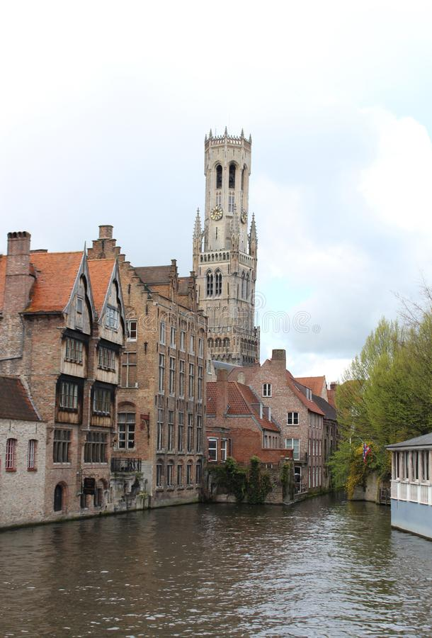 Image of Rozenhoedkaai, Dijver Canal in the cloudy day in Bruges, Belgium. Image of Rozenhoedkaai, Dijver Canal in the cloudy summer day in Bruges, Belgium royalty free stock photo