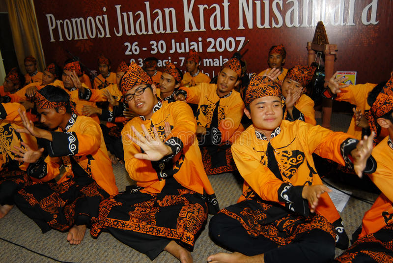 Dikir Barat. Is a musical form, native to the Malay Peninsula, that involves singing in groups—often in a competitive setting.  may be performed either stock photo