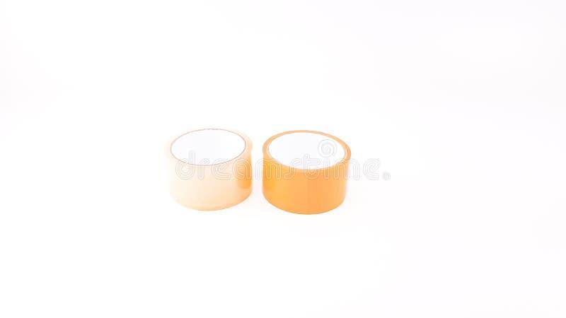 Dikke transparante plastic band en bruine plastic band in witte B stock foto's