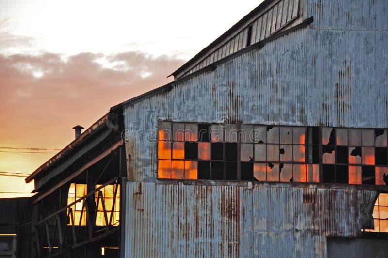dilapidated заход солнца стоковое фото rf