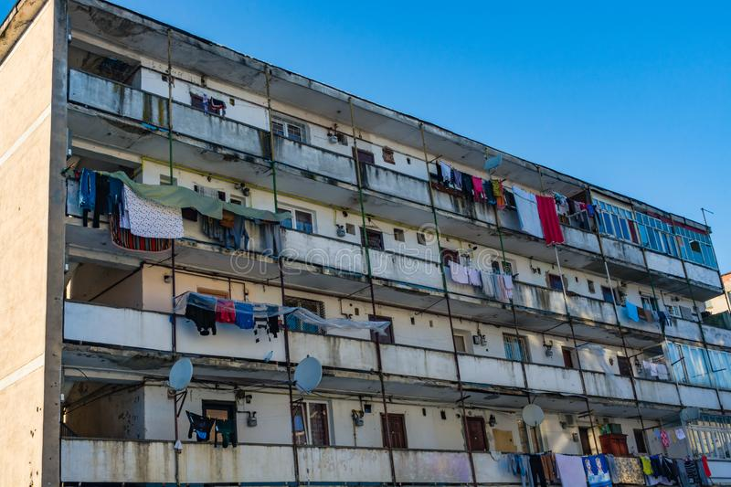Dilapidated block of flats. Dirty dilapidated block of flats with clothes hanging to dry on windows and balconies. Inspires poverty, indigence and misery royalty free stock image